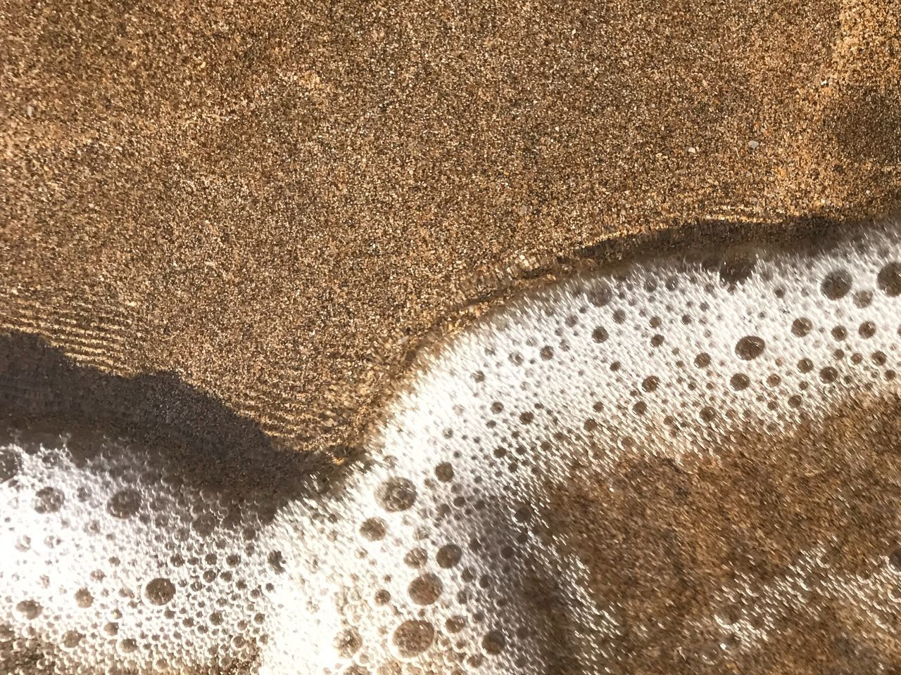 Close-up sand and waves. Sea foam. Backgrounds Beach Beauty In Nature Close-up Day High Angle View Maui Mauiphotography Nature No People Outdoors Sand Sand And Water Seafoam Sun And Sand Sun And Sea