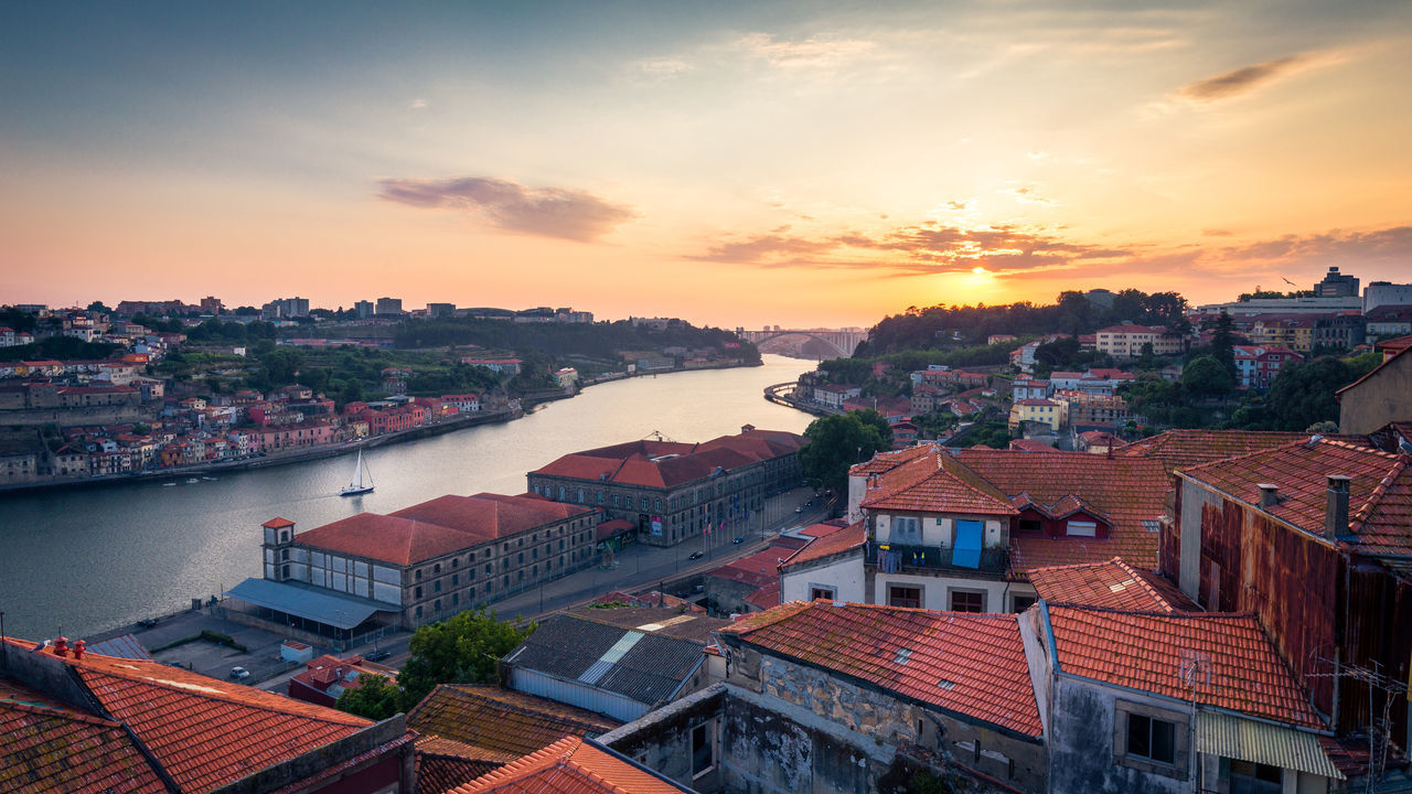 Sunset over the Douro and the roofs of Porto, Portugal Architecture City City Trip Cityscape Douro  High Angle View Porto Portugal Relaxation River Sailing Sailing Into The Sunset. Sunset Tiled Roof  Travel Travel Destinations