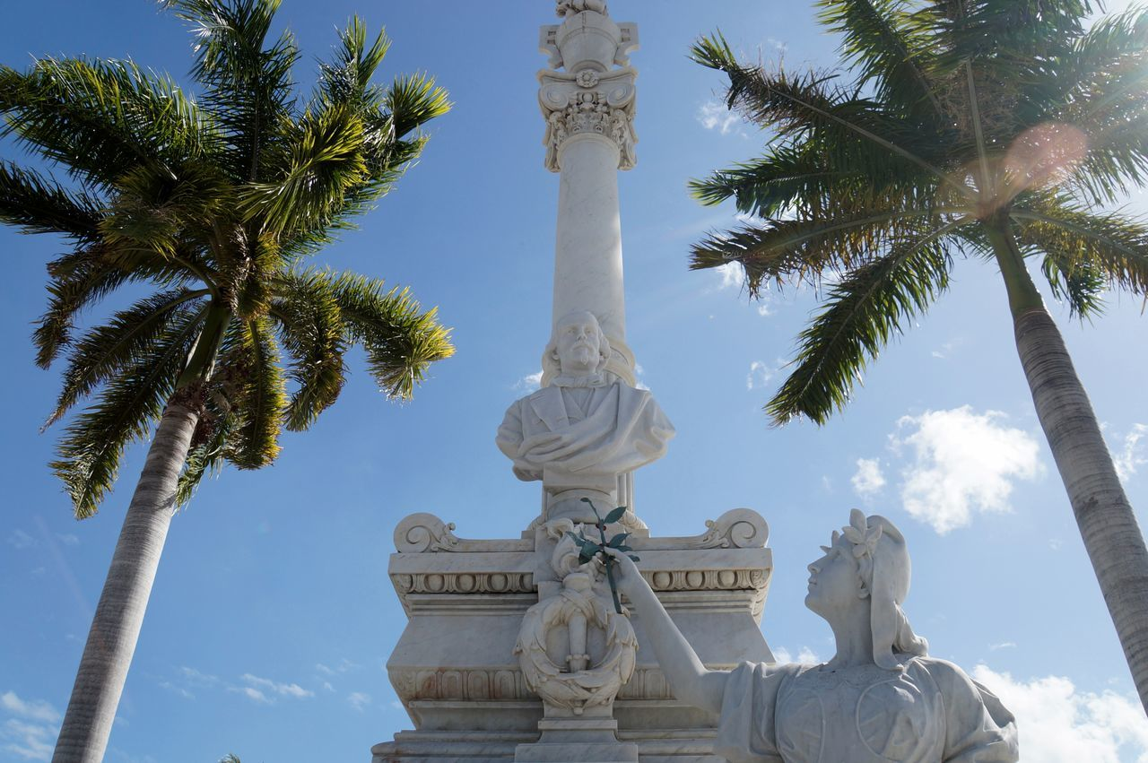 BYOPaper! Cemetery Cloud - Sky Cuba Cuba Collection Day EyeEm Gallery Grave Graveyard Graveyard Beauty Human Representation Low Angle View Monument Outdoors Palms Religion Sculpture Sky Spirituality Statue Statue The Street Photographer - 2017 EyeEm Awards