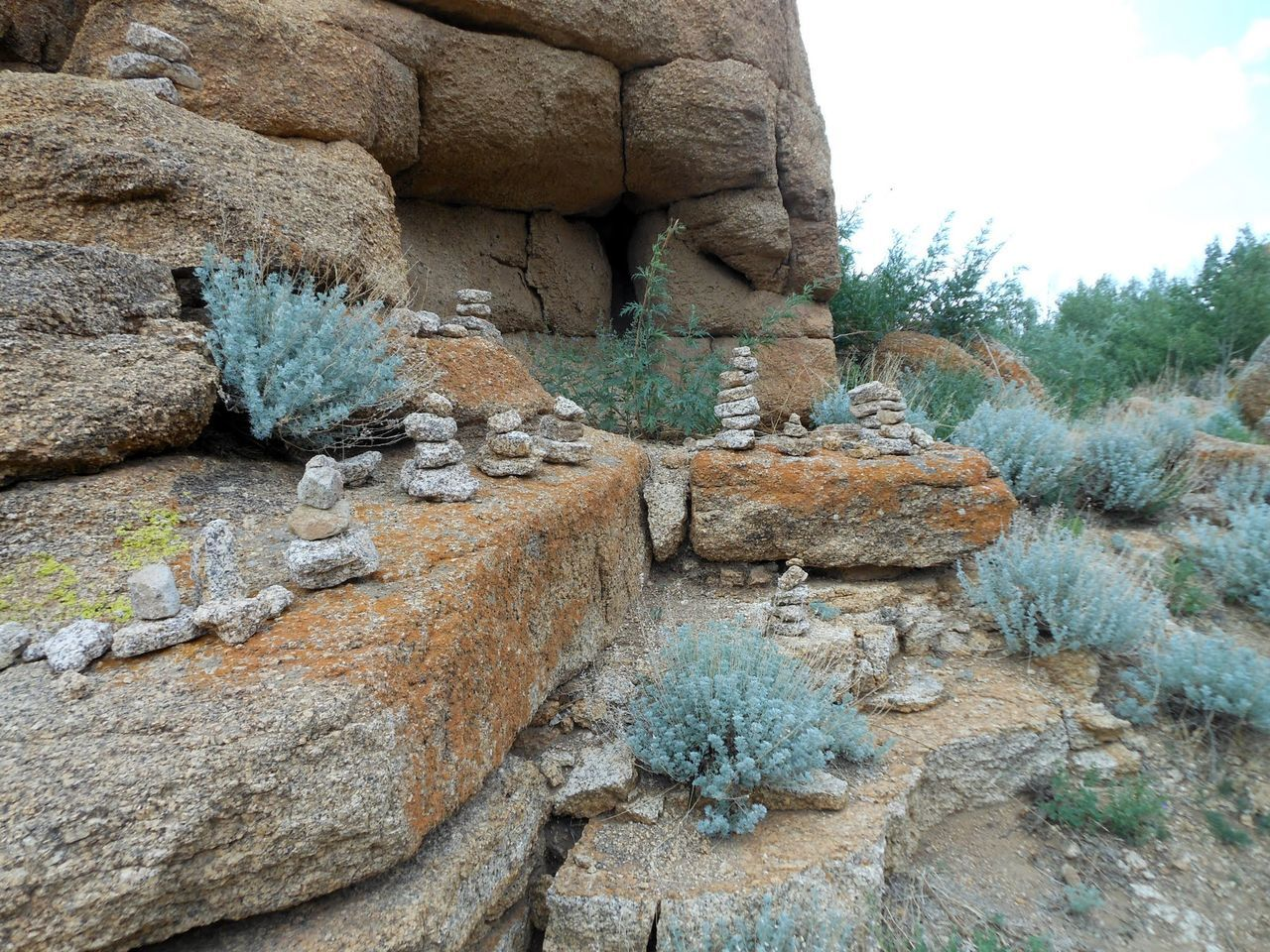 Beauty In Nature Day Eroded Geology Growth Low Angle View Nature No People Non-urban Scene Outdoors Physical Geography Rock Rock - Object Rock Formation Scenics Sky Stone Tranquil Scene Tranquility Travel Destinations