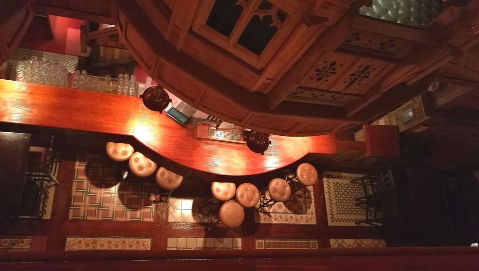The bar from above Indoors  Illuminated No People Bar Pub Traditional Alcohol Old Fashion Style Wood Stool View From Above Looking Down Irish Scottish WaxyOConnors Glasgow  Interior Design Modern Design Curves