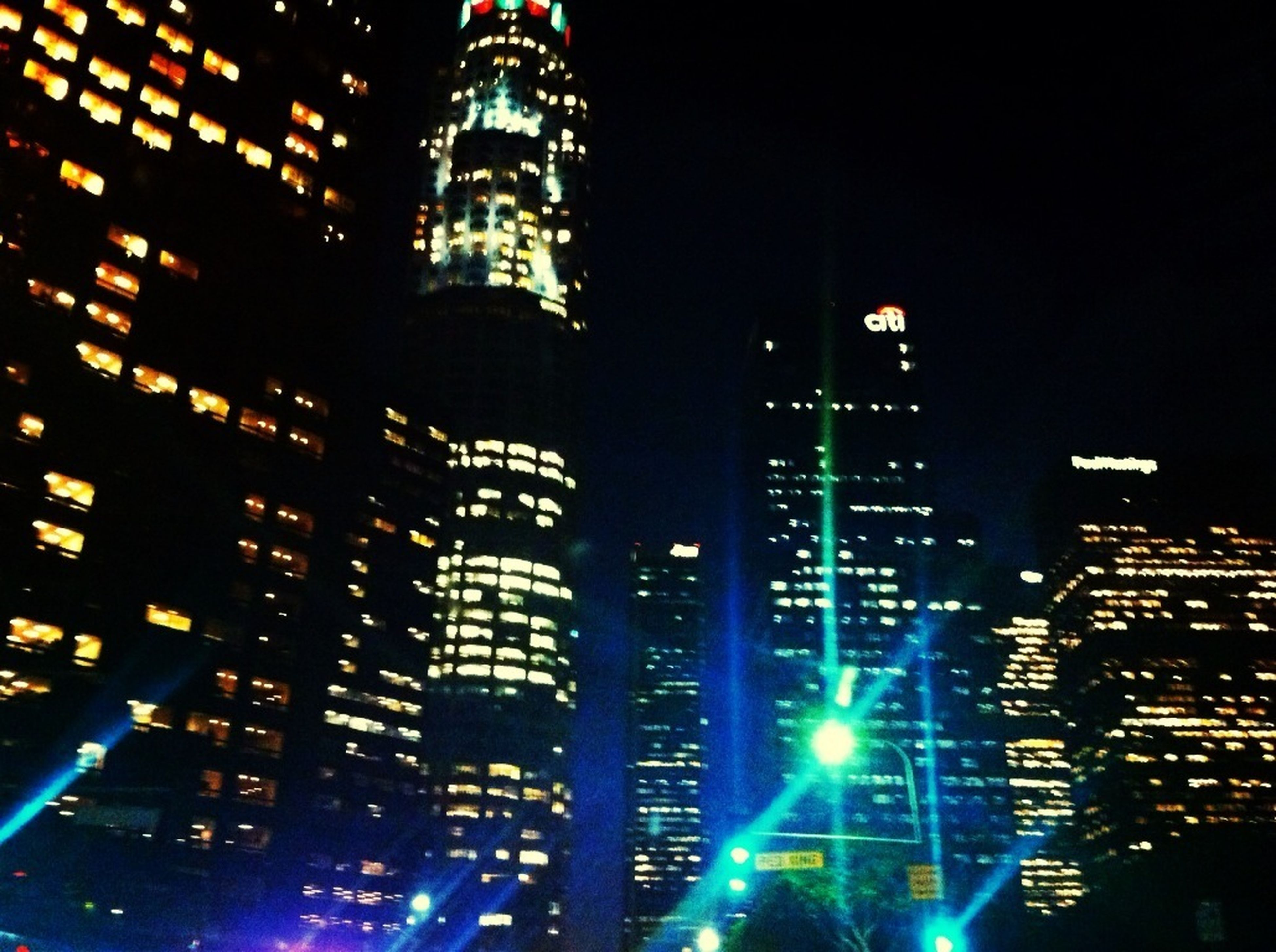 illuminated, night, building exterior, architecture, city, built structure, skyscraper, tall - high, tower, cityscape, modern, capital cities, office building, travel destinations, famous place, financial district, city life, international landmark, light - natural phenomenon, sky