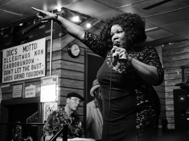 Blues Chicago Jazz Nightlife . Singing Bastards Club Concert Don't Let The Bastards Grind You Down Microphone Music Musician Nightlife Nora Nora Jean Bruso Performance Pointing Pointing Fingers Singer  Strong Voice