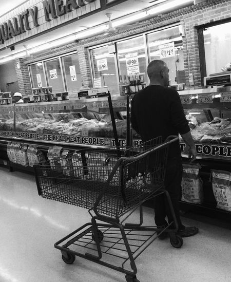 IPS2016People 1-22-16 Patiently Waiting Customer Shopping at the largest meat counter I've ever seen. Ip6+ Iphonephotography Blackandwhite Meat Market Shopping Time AlamoTX