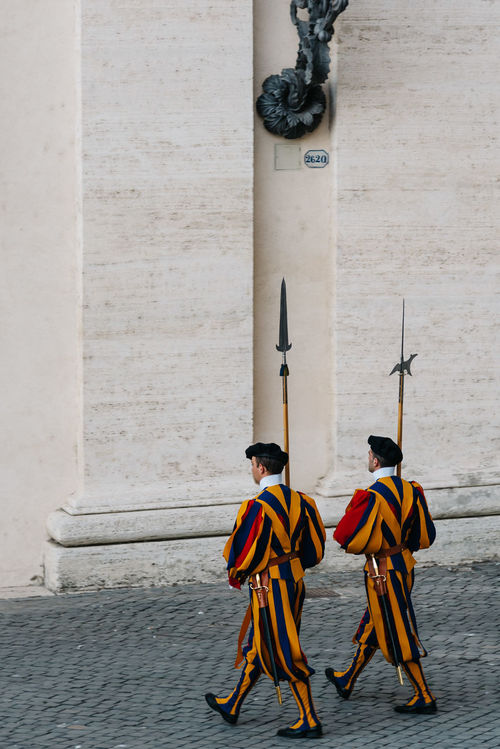 Soldiers of Swiss Guards in the entrance to Vatican City in Rome Architecture Army Basilica Building Exterior Built Structure Day Guards Men Military Uniform Outdoors People Pope Real People Romans Soldier Swiss Swiss Guard Togetherness Travel Destination Travel Destinations Two People Uniform Uniform Vatican Vatican City