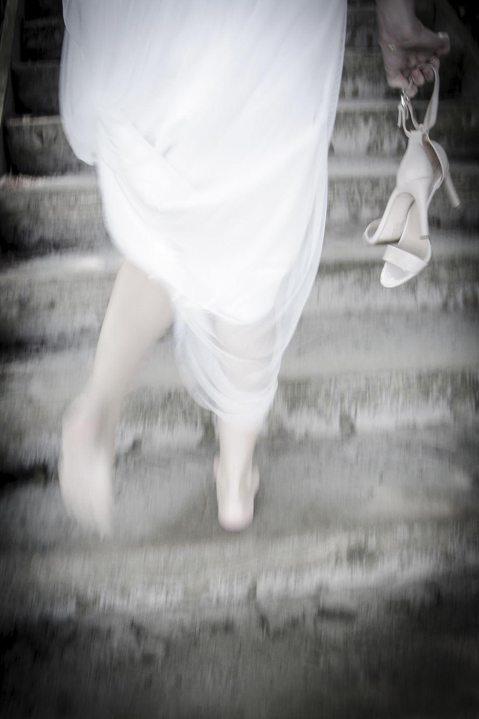 One Person White Color Barefoot People Shoe Wedding Dress Love Weddingday  Weddingshoot Wedding Photography Wedding Nature Running Bride Bride Bride Running Shoes Bride Shoes