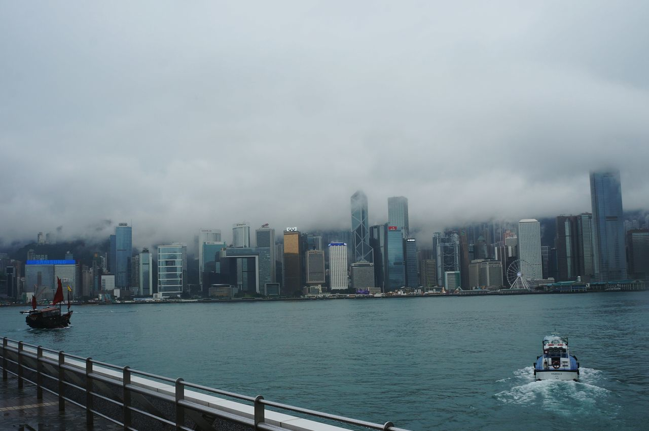 City Urban Skyline Skyscraper Cityscape Architecture Outdoors Water Adapted To The City Colors Photography Eyem Best Shots HongKong Landscape Hkigers Rain Rainy Days ASIA Island Buildings Boat Gloomy Clouds Sky