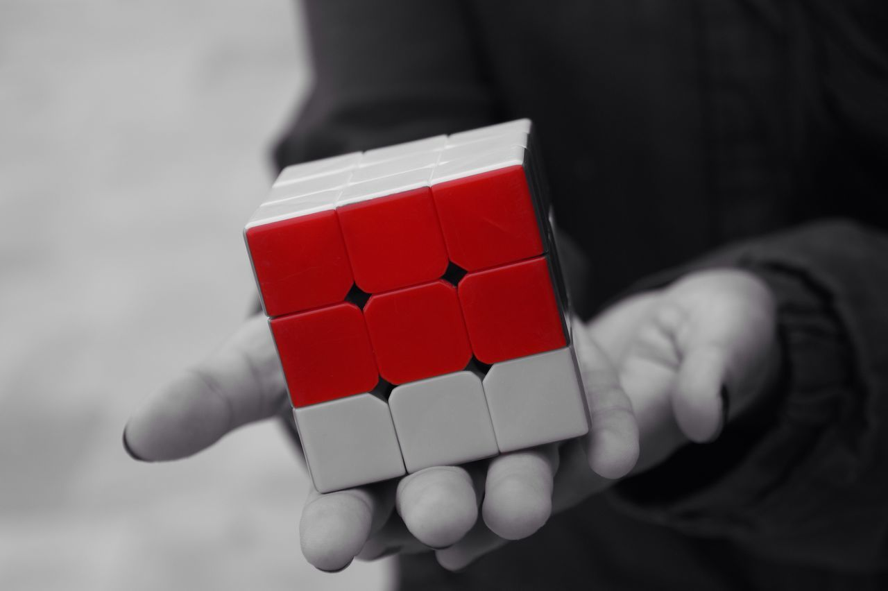 It was difficult but... finally she made one side! Red Real People Human Hand One Person Holding Focus On Foreground Close-up Christmas Human Body Part Day Outdoors Blackandwhite Cube Rubik's Cube