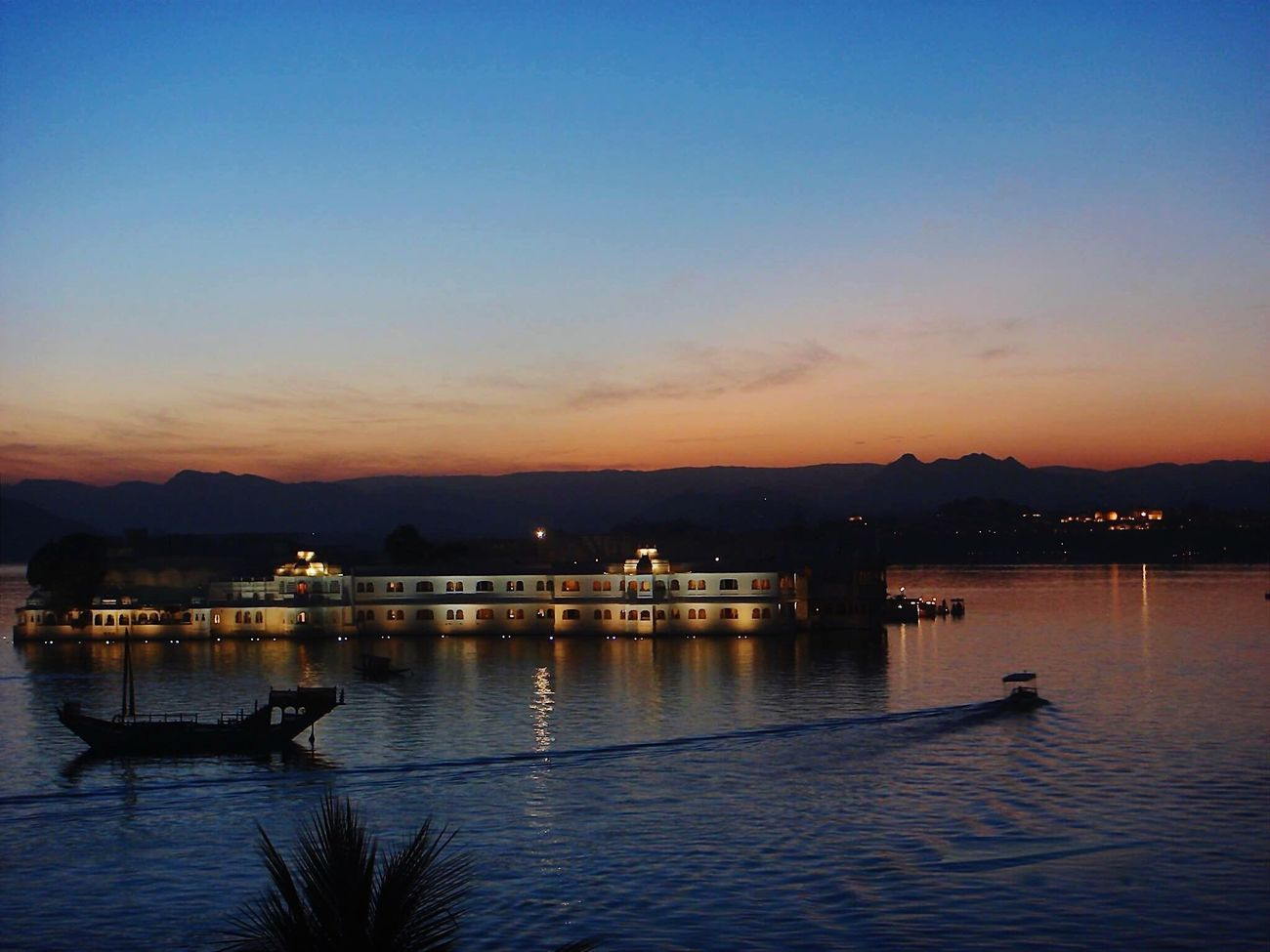 Lake Palace, Udaipur, India. Water Reflection Sunset Nautical Vessel Mode Of Transport Tranquil Scene Scenics Outdoors Sky No People Lake Mountain lakeview Waterfront Silhouette lake Palace Luxury Luxuryhotel 5 Star Service 5 Star Hotel