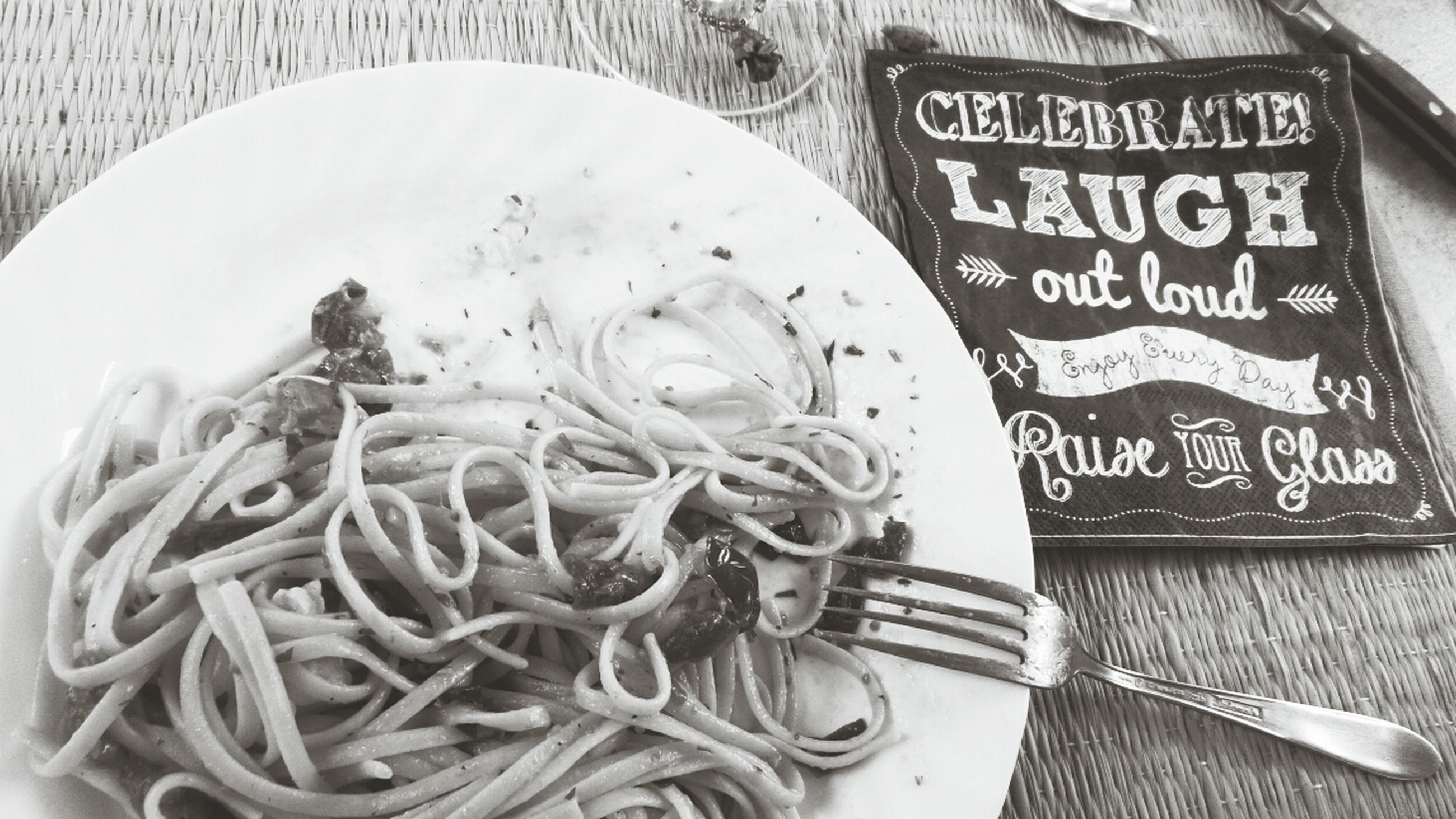 text, western script, indoors, food and drink, food, communication, still life, close-up, high angle view, healthy eating, no people, freshness, plate, table, non-western script, creativity, art and craft, noodles, day, human representation