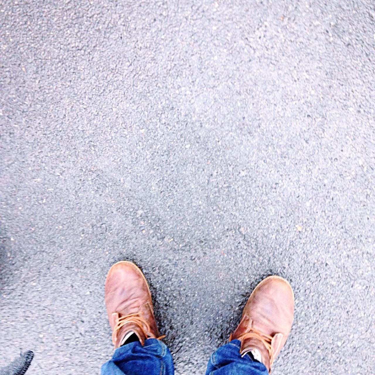 shoe, low section, human leg, standing, human body part, street, directly above, one person, high angle view, road, personal perspective, one man only, asphalt, men, outdoors, day, only men, lifestyles, puddle, real people, people, adult, nature, adults only, close-up