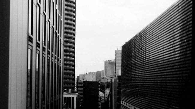Architecture Built Structure City Building Exterior Tall - High Sky SkyscraperTokyo Days Office Building Tall Outdoors Modern Day No People Development Diminishing Perspective Building Story City Life Urban Scene Settlement Monochrome Cityscape Cityscapes City
