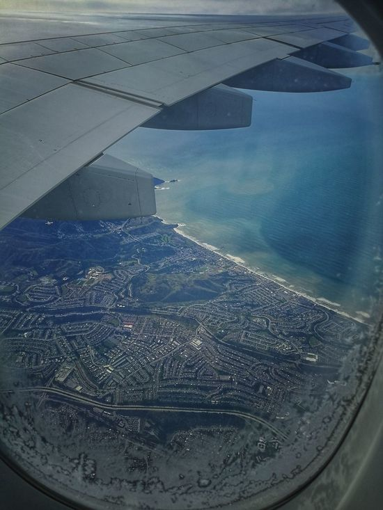 A380-800 Aircraft Wing Looking Through Window Day Aerial View San Francisco Water Ocean