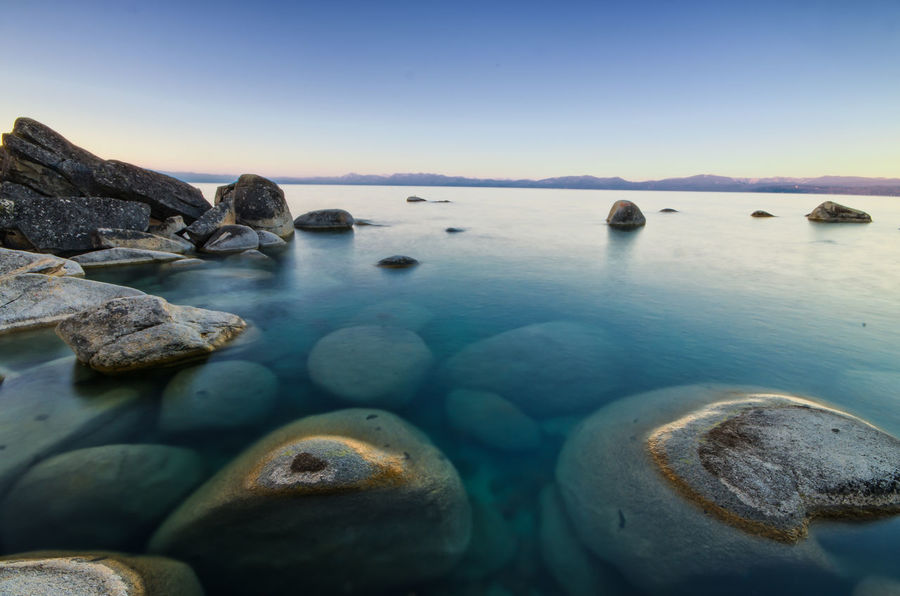 Good morning Tahoe Crystal Bay Sea Water Rock - Object No People Scenics Blue Tranquil Scene Nature Outdoors Beauty In Nature Beach Travel Destinations Sky Sunset Day Horizon Over Water