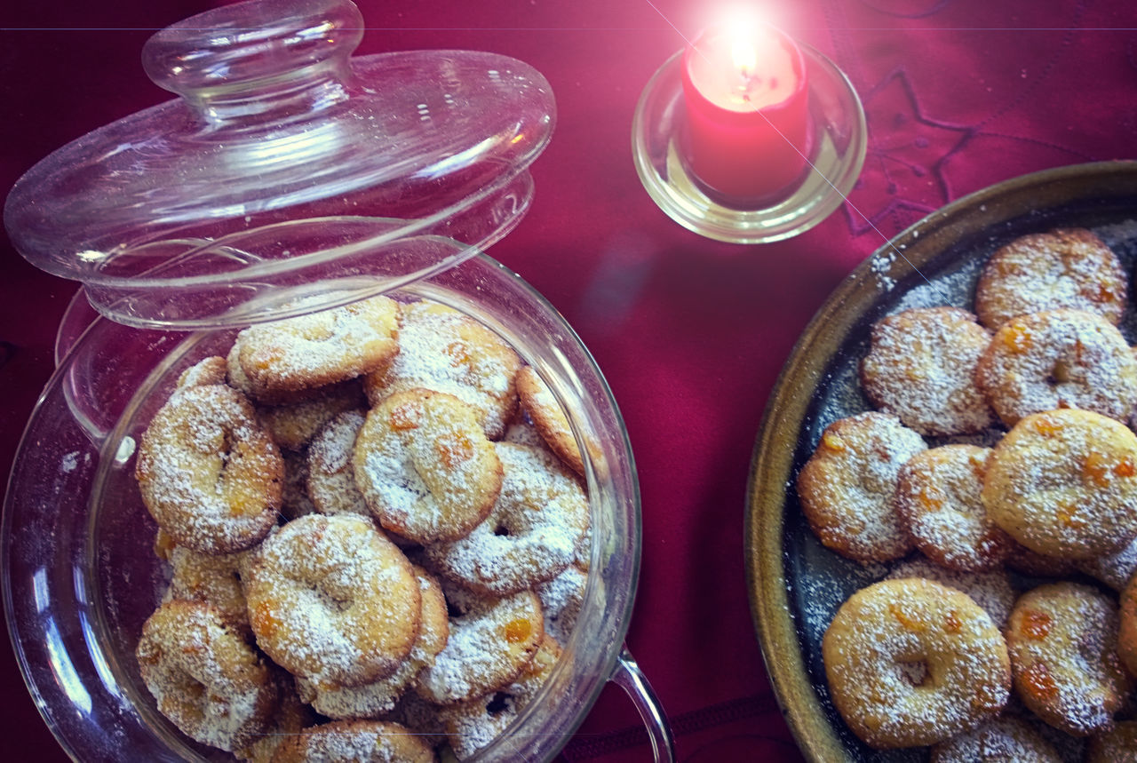 Christmas decorated table with traditional homemade cookies, lit candle and red tablecloth Bakery Christmas Eve Close-up Day Dessert Food Food And Drink Freshness Fullfillment Holiday Homemade Cookies Indoors  Indulgence Jar Nibble No People Ready-to-eat Sugar Sweet Food Table Temptation Tradition Unhealthy Eating