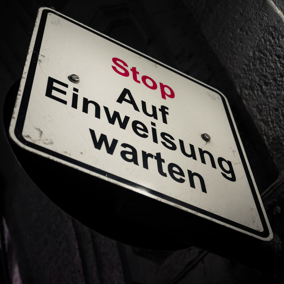Stop - Wait for Guidance ... or is it the Entrance of a Lunatic Asylum and you have to wait for Committal? Autocratic Close-up Command Command And Obedience Committal Communication Guidance Guide Instruction Low Angle View Master And Servant OBEY Order Road Sign Sign Stop Text Wait