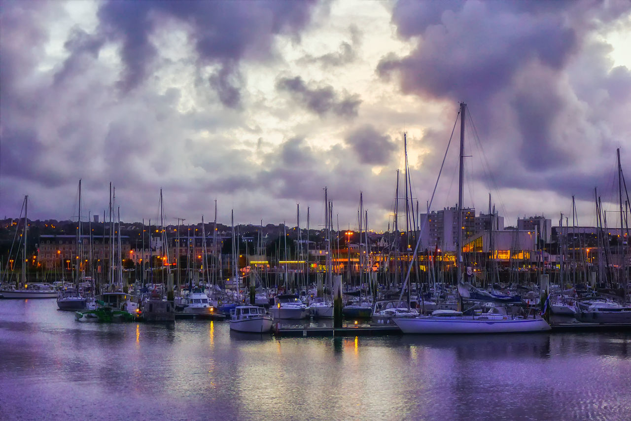 Evening view from the pier to yachts in the cozy port city of Cherbourg-Oktervill (Cherbourg) in the north-west of France. Peninsula of Cotentin, on the coast of the English Channel. Beauty In Nature Cloud - Sky Day Evening Sky EyeEm Best Shots Getty Images Harbor La Mancha Mast Mode Of Transport Moored Nature Nautical Vessel No People Normandie Normandy Outdoors Pier Sailboat Sea Sky Transportation Water Waterfront Yacht