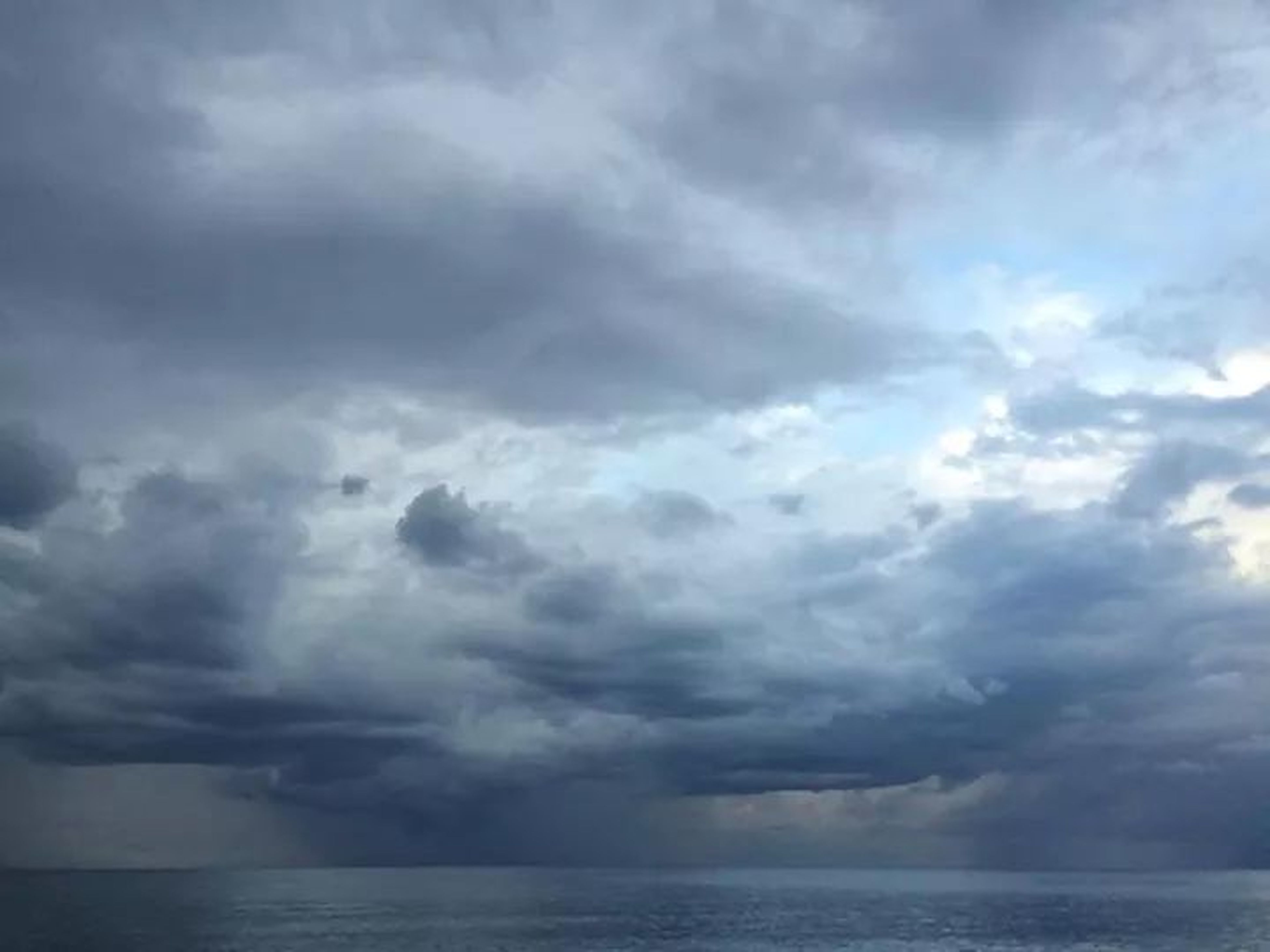 sky, cloud - sky, scenics, cloudy, tranquil scene, beauty in nature, sea, tranquility, water, waterfront, nature, horizon over water, weather, overcast, cloud, cloudscape, idyllic, storm cloud, outdoors, dramatic sky
