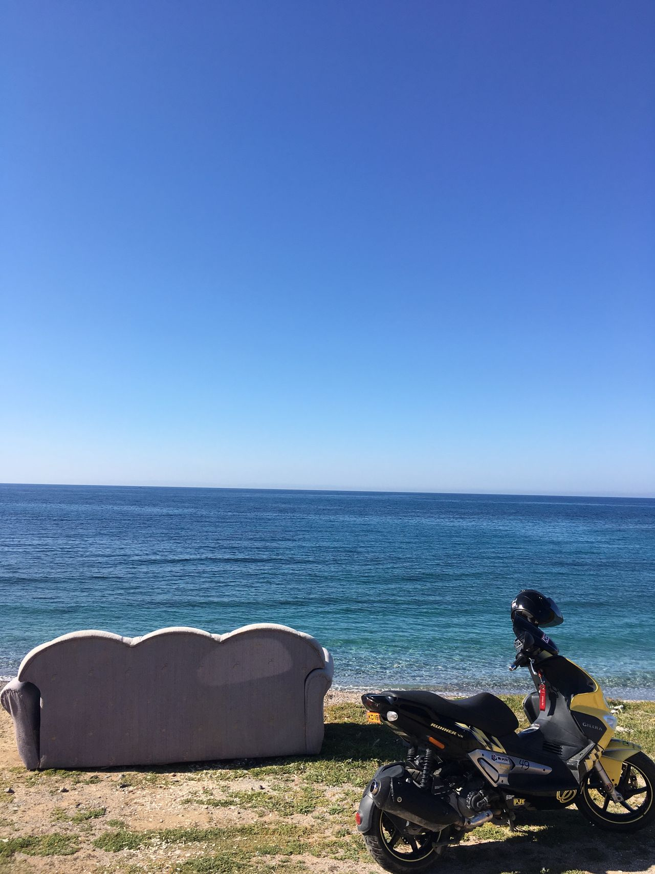 Sea Sitting Horizon Over Water Clear Sky Lifestyles Blue One Person Real People Leisure Activity Water Outdoors Nature Sky Day Scenics Motorcycle Beach Beauty In Nature