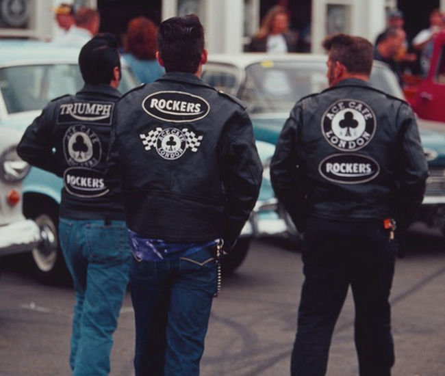 Biker Boys, Triumph Rockers Bikers Brotherhood Mc Casual Clothing City Life Communication Day Documentary Nature Photography Photography Taking Photos A Focus On Foreground Leisure Activity Lifestyles Men Person Photographing Rear View Reportage Images Taking Photos Photography From My Point Of View Rockerstyle Standing Street Technology Text Transportation Travel Triumph Motorcycle Western Script