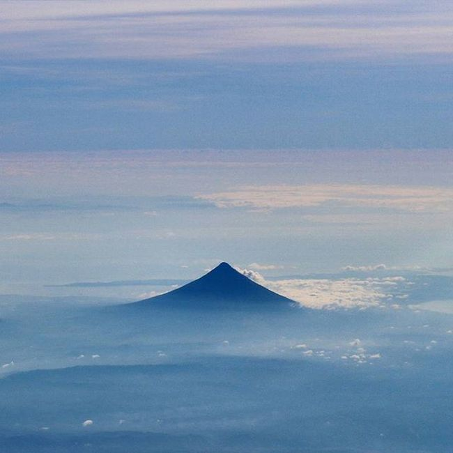 """""""Be absolutely perplexed and awed by how every little things added up and brought you somewhere wonderful."""" Image: Aerial view shot of Mt. Mayon (Legaspi City, Albay, Philippines) Mtmayon Wheninlegaspi Skyporn Aerialview Travelview Drones Igdrone Aeronotics Mountains NAIA Wanderlust Travel Igersphilippines Igersmanila GrammerPH Tourismphl World_captures Dailylitrato Travelview Sky_captures IGDaily ©BrixtonDaza"""