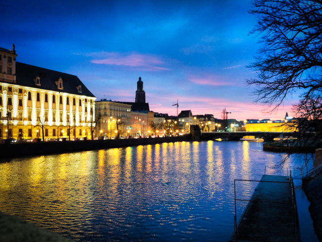 Taken while I was walking to Wroclaw University. Architecture Bridge City City Lights Citybreak Cityscape Cloud - Sky Colors Of The Night Illuminated Long Nights  Mobilephotography Night Night Lights No People Pastel Reflection Reflections In The Water River Romantic Evening Sky Sunset Travel Destinations Waterfront