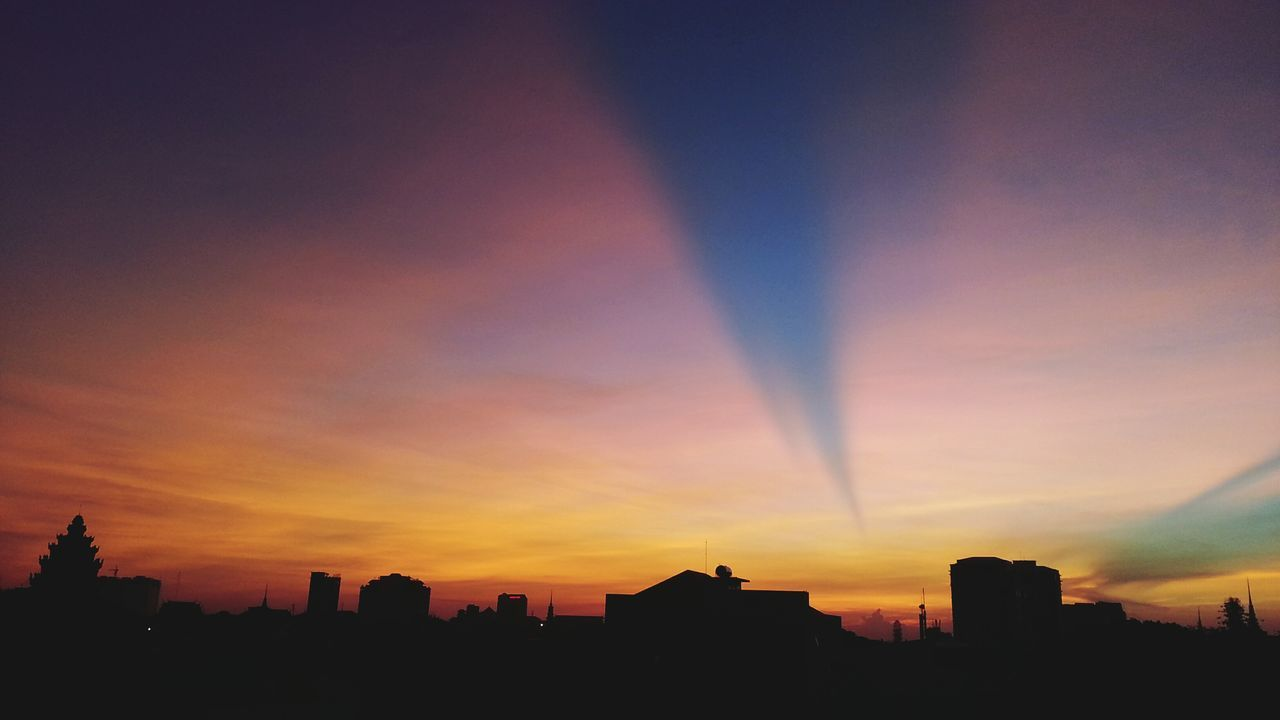 Anticrepuscular sky over Phnom Penh dawn sunrise Cambodia phnompenh Sunrays atmospheric sky silhouettes of a city horizon Daybreak rooftops colour of life From My Window sky Landscape_Collection anticrepuscular rays cityscapes Rays of light Skyline shadows 43 Golden Moments