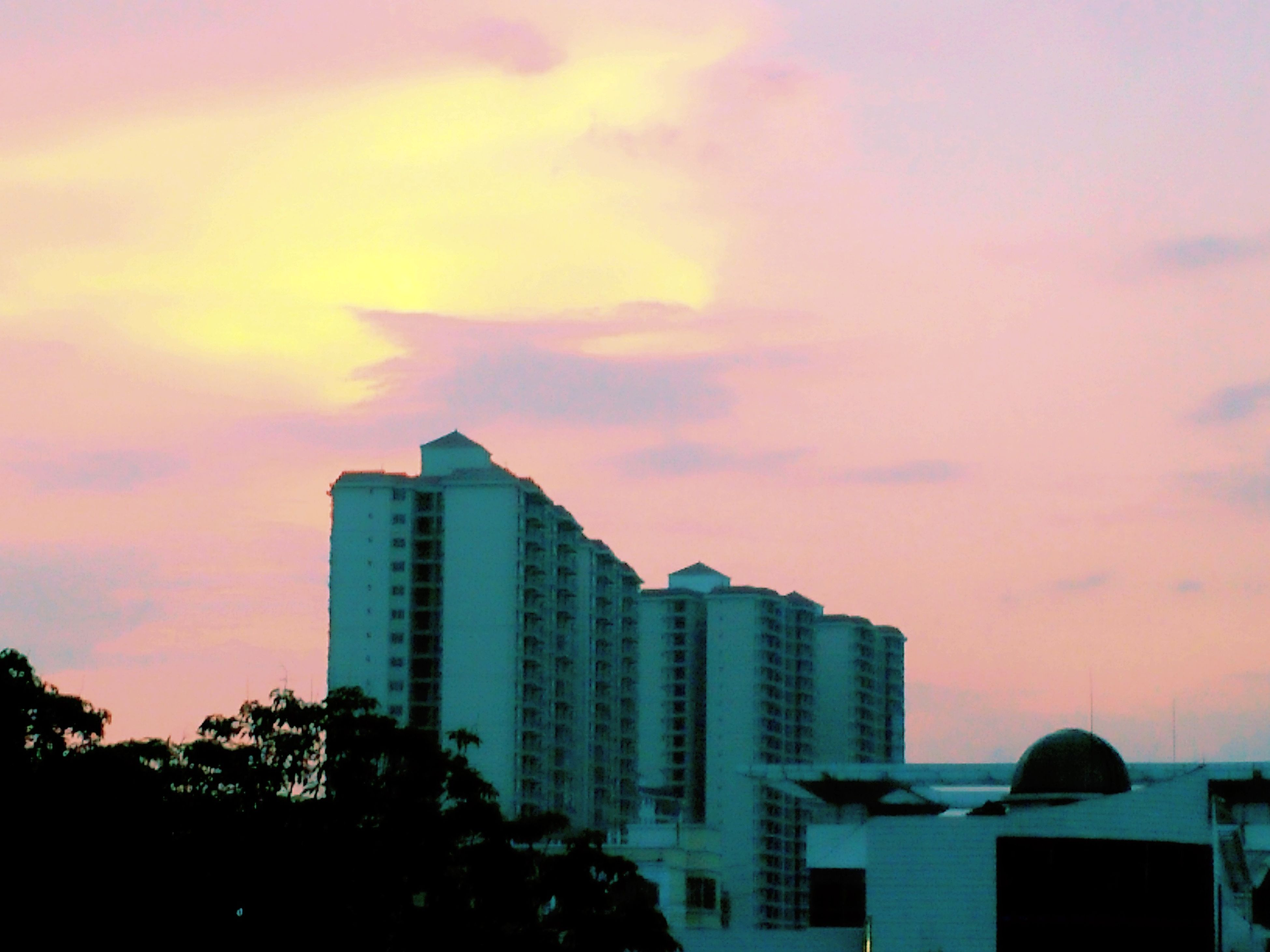 building exterior, architecture, built structure, sunset, sky, city, orange color, cloud - sky, building, residential building, low angle view, residential structure, cloud, outdoors, cloudy, house, dusk, no people, silhouette, nature