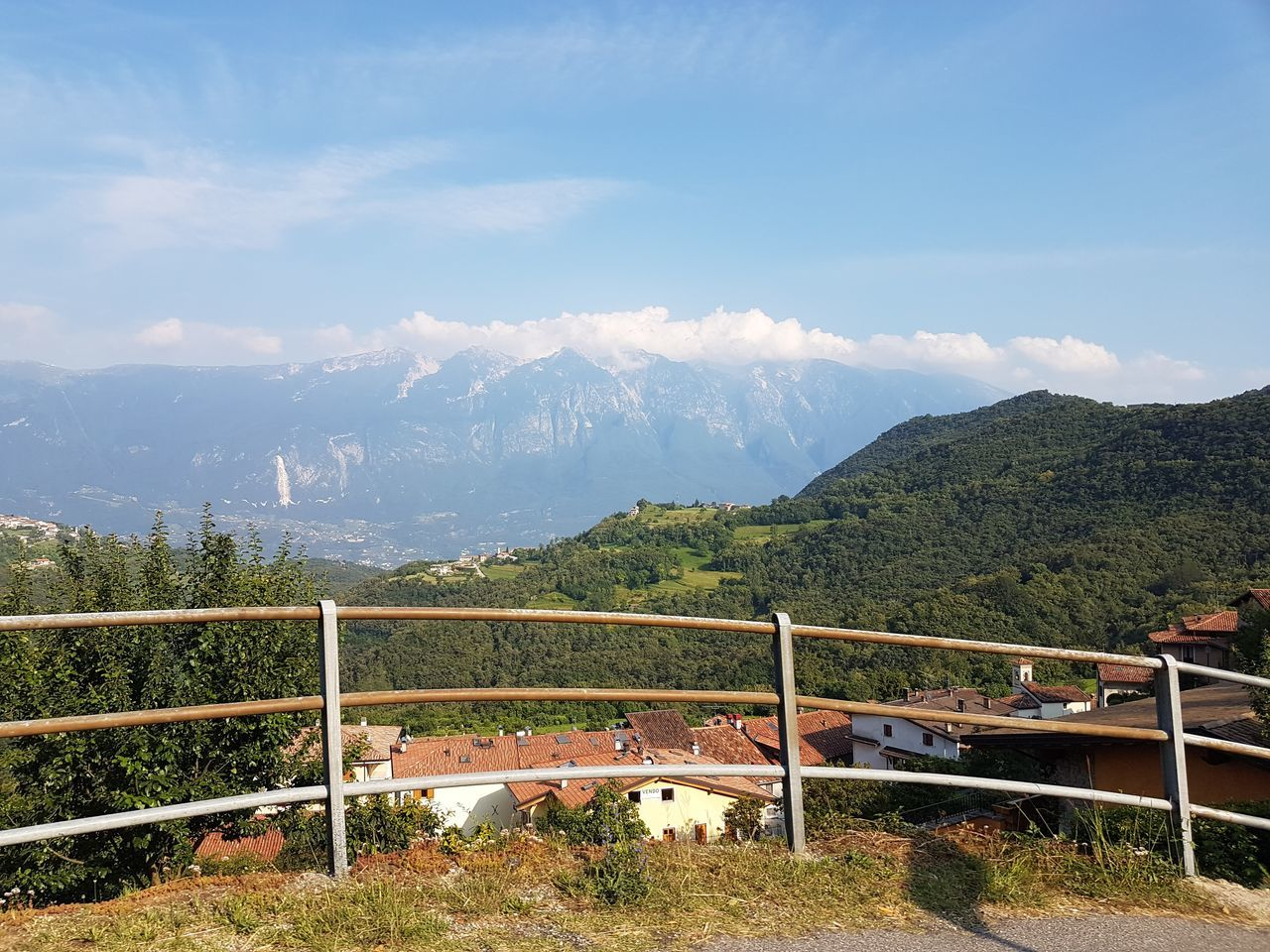 mountain, railing, mountain range, scenics, nature, high angle view, beauty in nature, day, sky, tranquility, tranquil scene, outdoors, no people, landscape, built structure, water, tree, architecture
