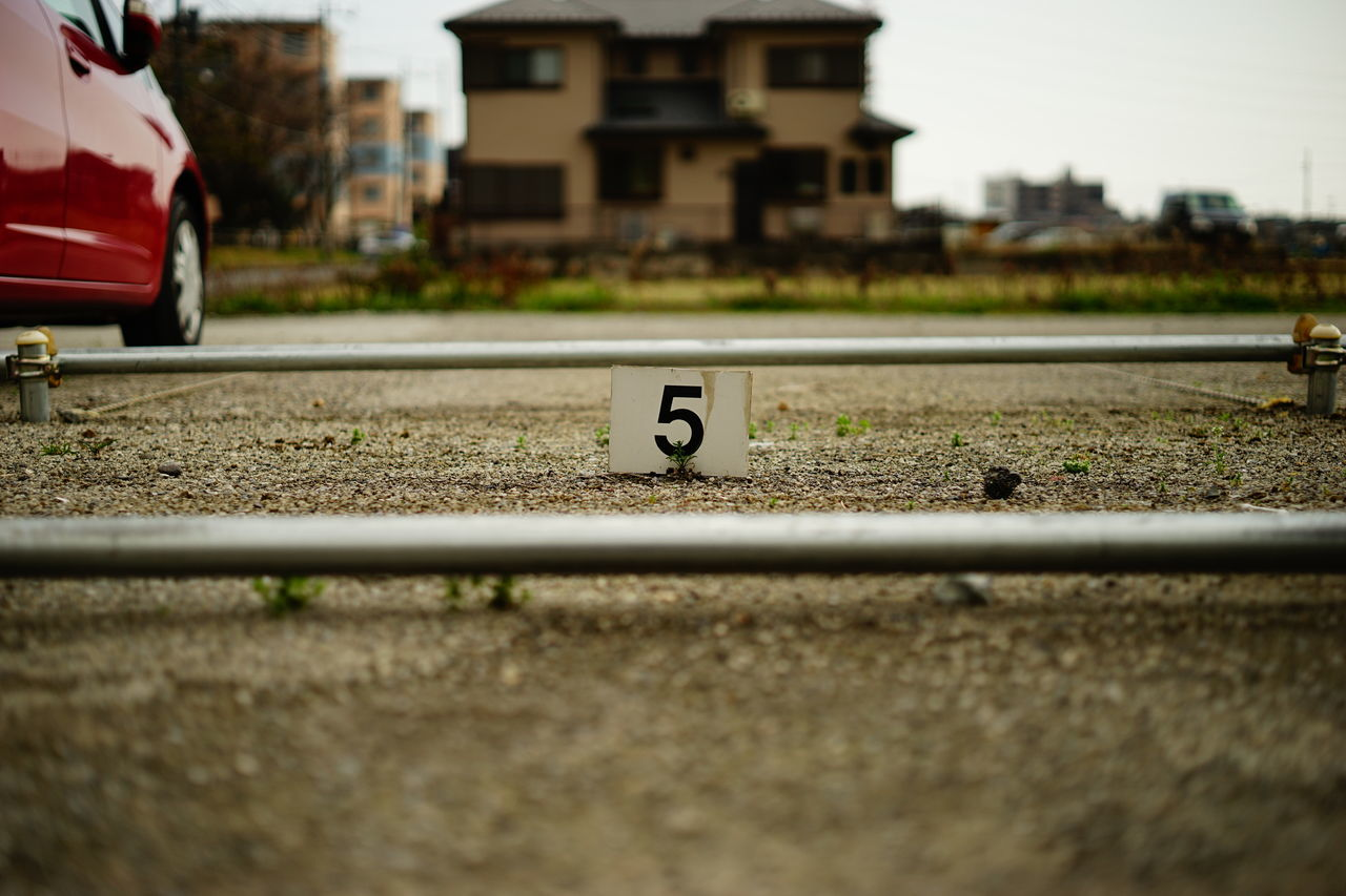 Close-Up Of Number Five Indicating Parking Empty Space