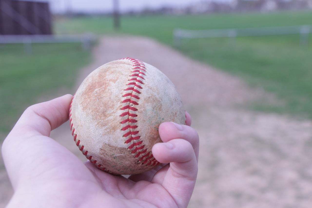 Ball Baseball - Ball Baseball - Sport Baseball Bat Baseball Pitcher Baseball Player Close-up Day Focus On Foreground Holding Human Body Part Human Hand Leisure Activity Lifestyles Men One Person Outdoors People Personal Perspective Real People Sport Sportsman