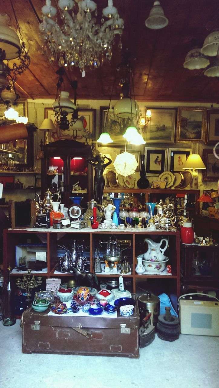 indoors, retail, store, variation, illuminated, shelf, large group of objects, antique, no people, day