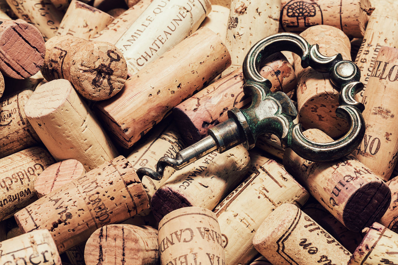 Old corkscrew on a pile of used wine corks Alcohol Alcoholic  Backgrounds Bottle Close-up Concept Cork - Stopper Corks Corkscrew Drink Drinking Indoors  Lying Down No People Old Restaurant Used Things Vintage Wine Wine Bottle Wine Cork Wine Corks Wine Tasting Winery