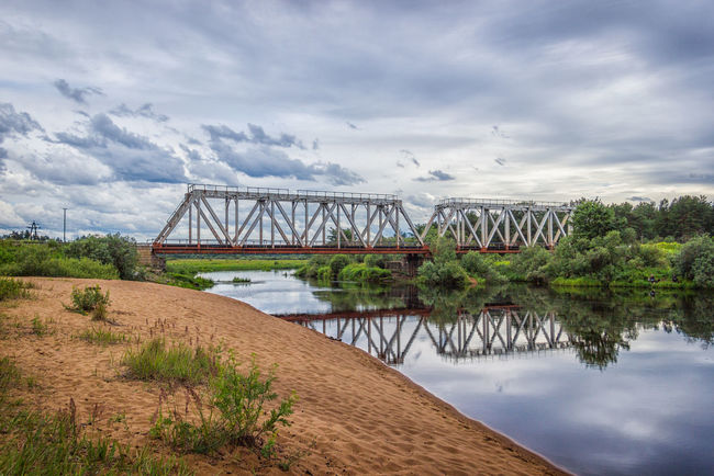 Railway bridge over the river Volchina. The beach next to the railway bridge, Maksatikha station. Beach Bridge Bridge - Man Made Structure Built Structure Day Engineering Landscape Maksatiha Maksatikha Nature No People Outdoors Railroad Railway Bridge River Russia Travel Volchina Water