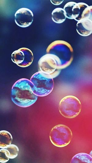 Circle Multi Colored Bubble Mid-air Outdoors Lens Flare Fragility Flying Colorful No People Full Frame