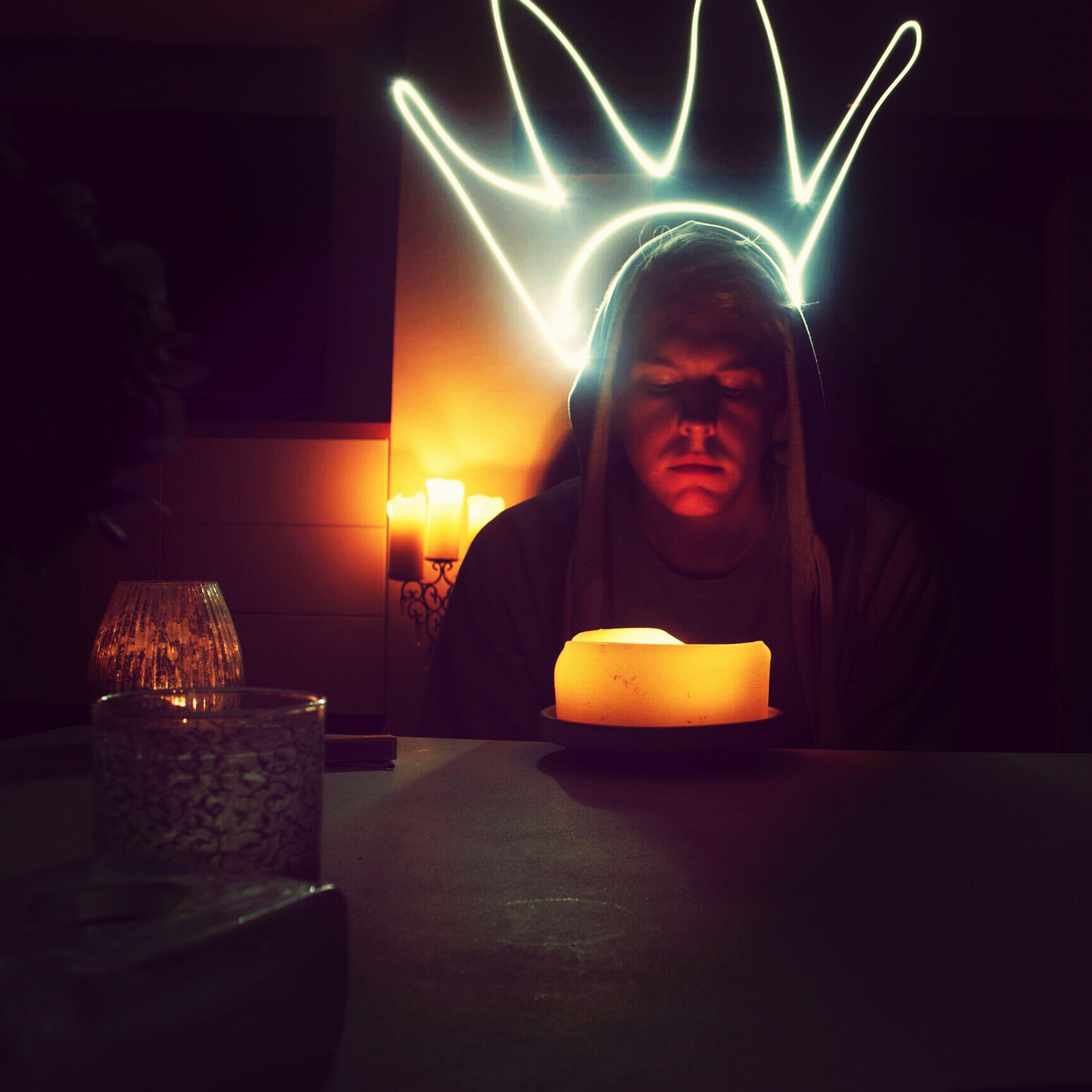 illuminated, night, indoors, glowing, lifestyles, leisure activity, burning, flame, sitting, orange color, candle, fire - natural phenomenon, dark, lighting equipment, celebration, togetherness, standing