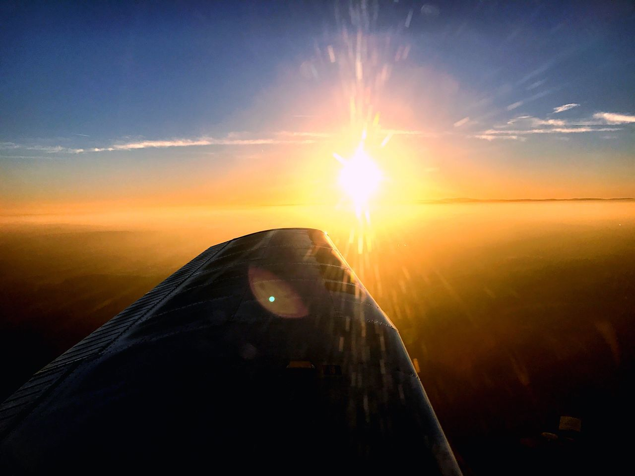 sunset, sun, transportation, lens flare, sky, airplane, sunbeam, no people, travel, sunlight, nature, scenics, journey, beauty in nature, outdoors, mode of transport, aircraft wing, close-up, airplane wing, air vehicle, flying, water, day