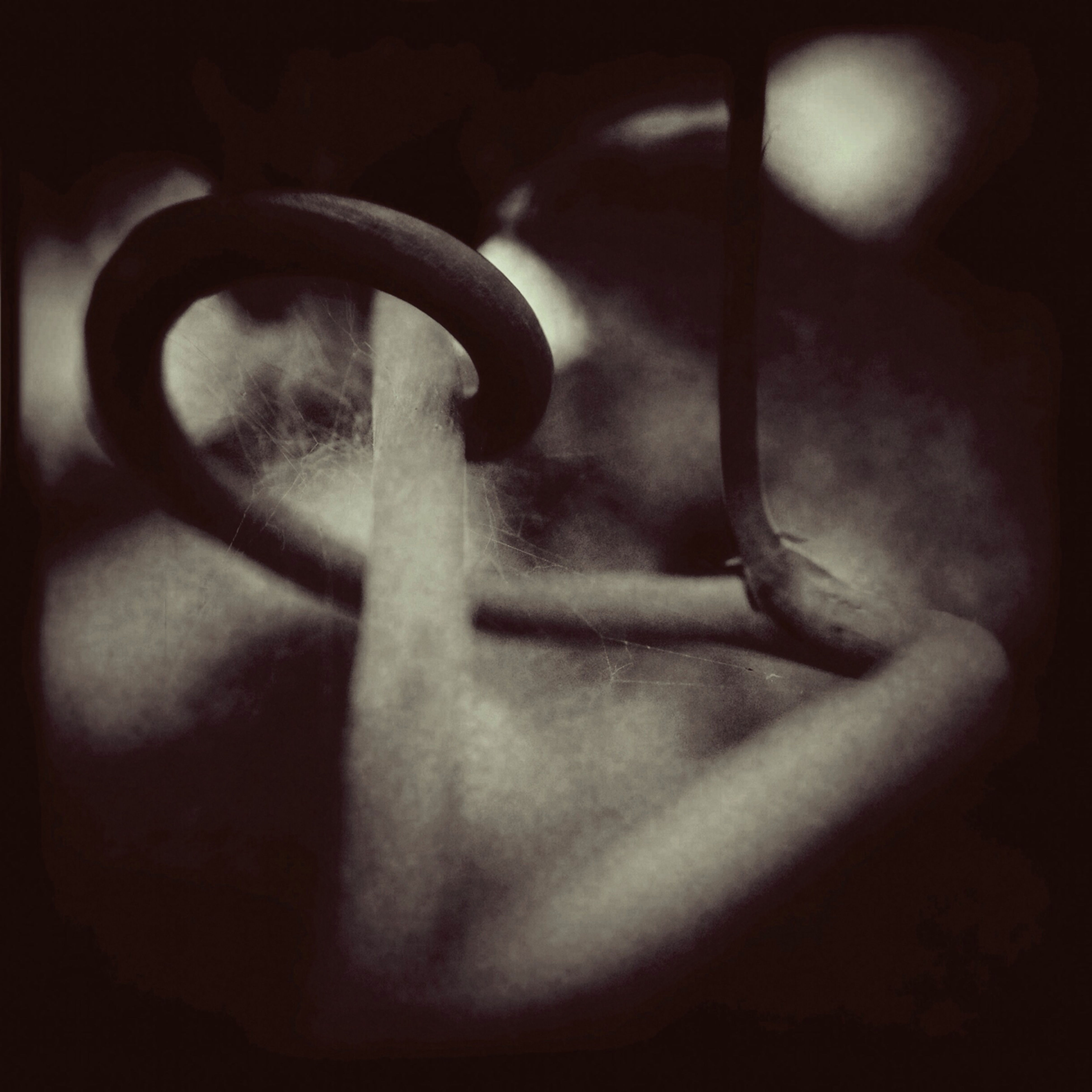 indoors, close-up, metal, single object, shadow, no people, dark, focus on foreground, still life, selective focus, handle, sunlight, metallic, day, protection, vignette, wall - building feature, home interior, shape, chain
