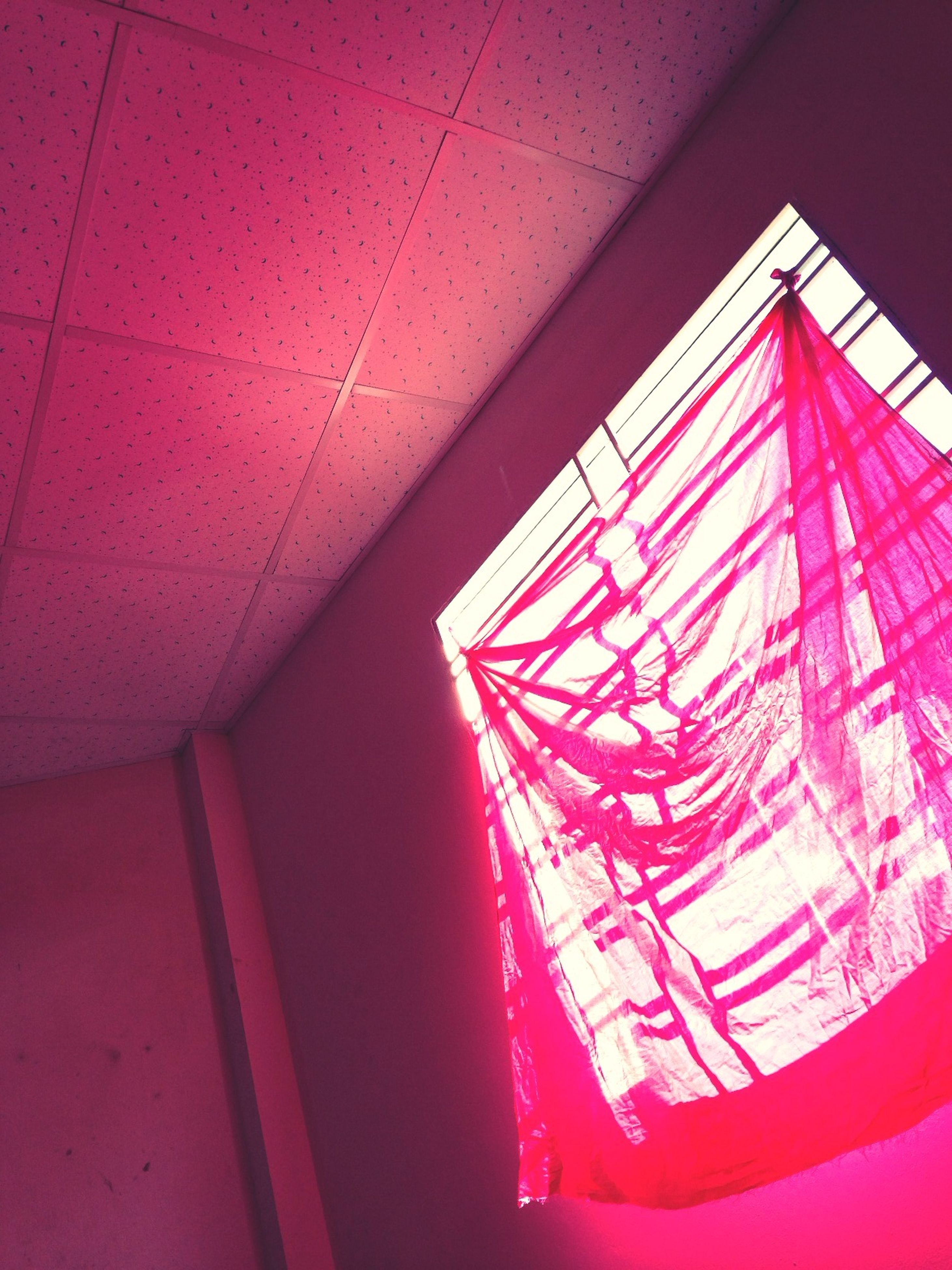 indoors, ceiling, red, pattern, low angle view, illuminated, architecture, lighting equipment, built structure, design, wall - building feature, no people, home interior, geometric shape, interior, modern, absence, staircase, empty, sunlight