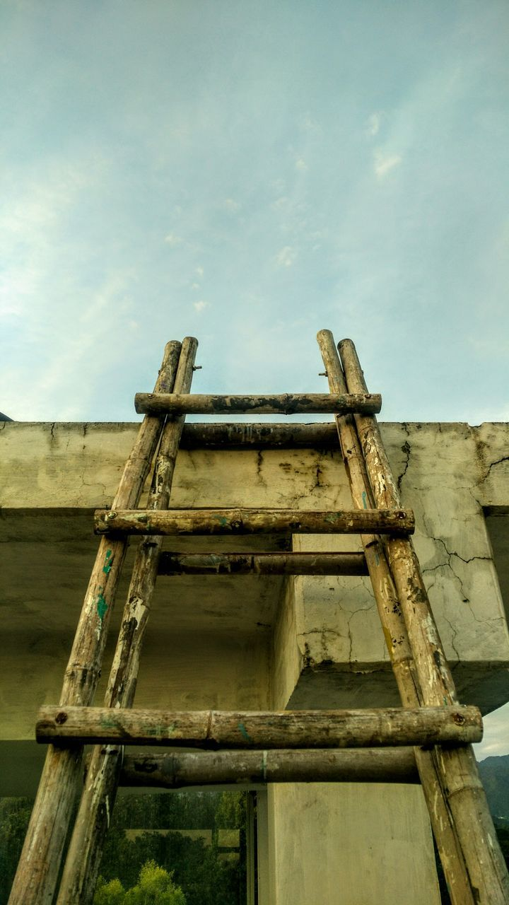 Low Angle View Of Bamboo Ladder And Built Structure Against Sky