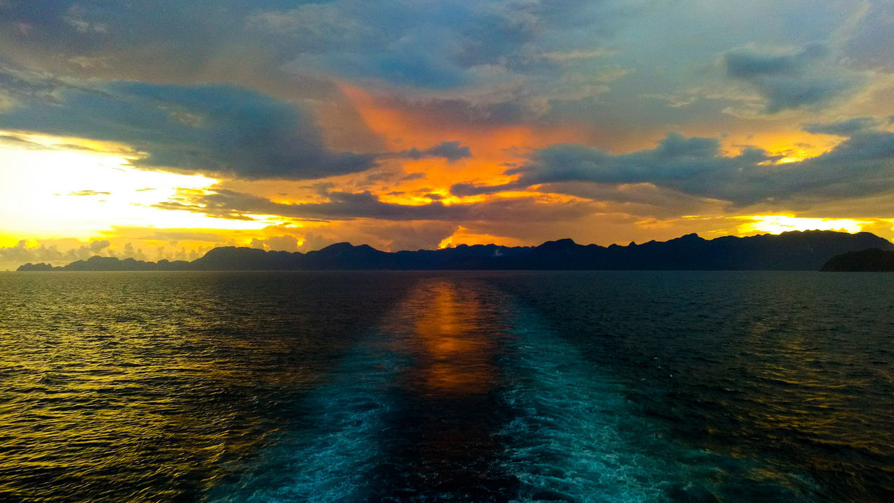 Traveling Home For The Holidays Sunset Landscape Reflection Dramatic Sky Water Mountain Cloud - Sky Lake Sky Nature Outdoors Scenics No People Beauty In Nature Galaxy Day Coron Philippines Ferry Manila Goodbye Nighttrip