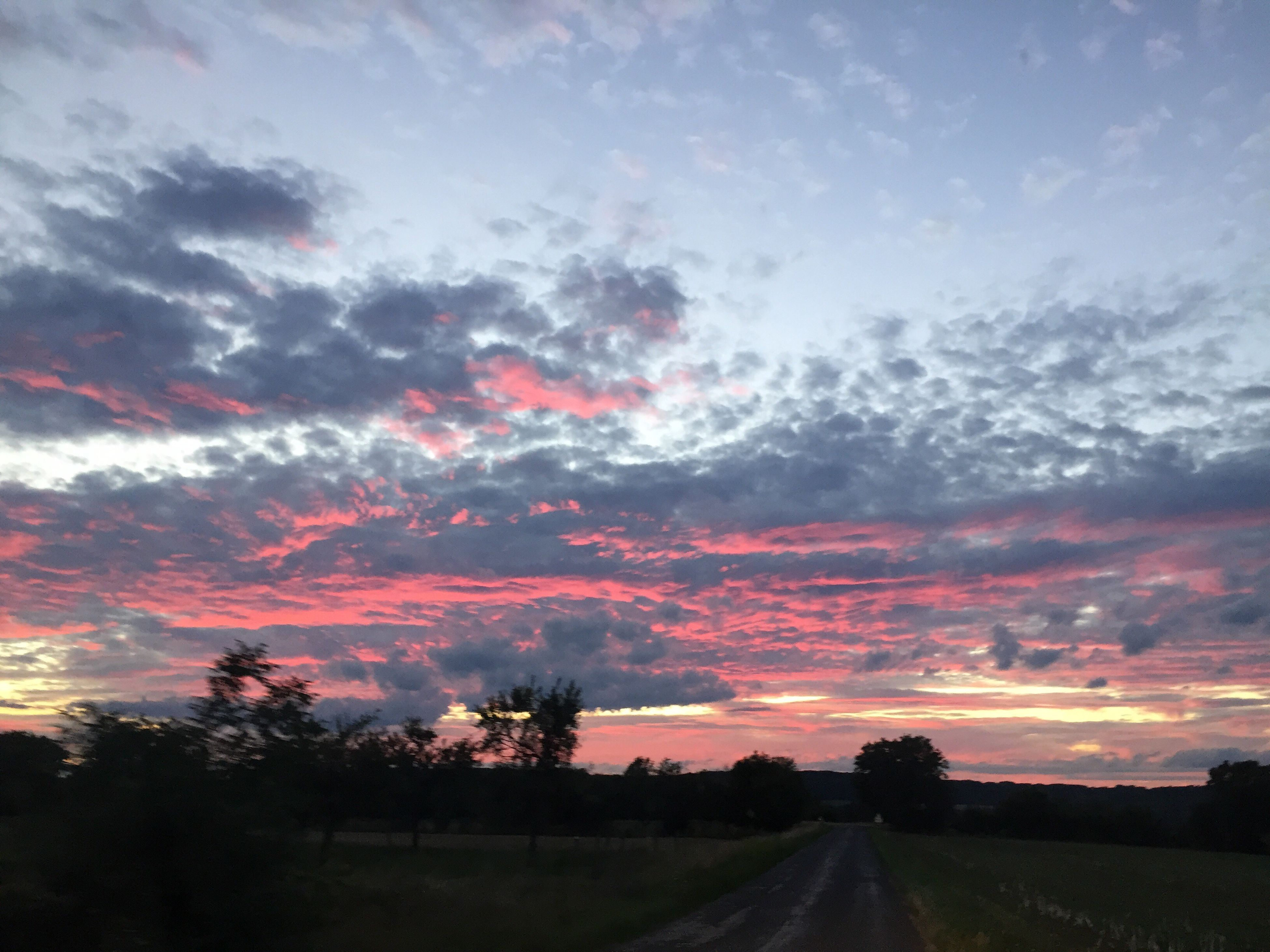 road, the way forward, sky, scenics, nature, sunset, cloud - sky, landscape, beauty in nature, tranquil scene, tranquility, transportation, no people, tree, silhouette, outdoors, day