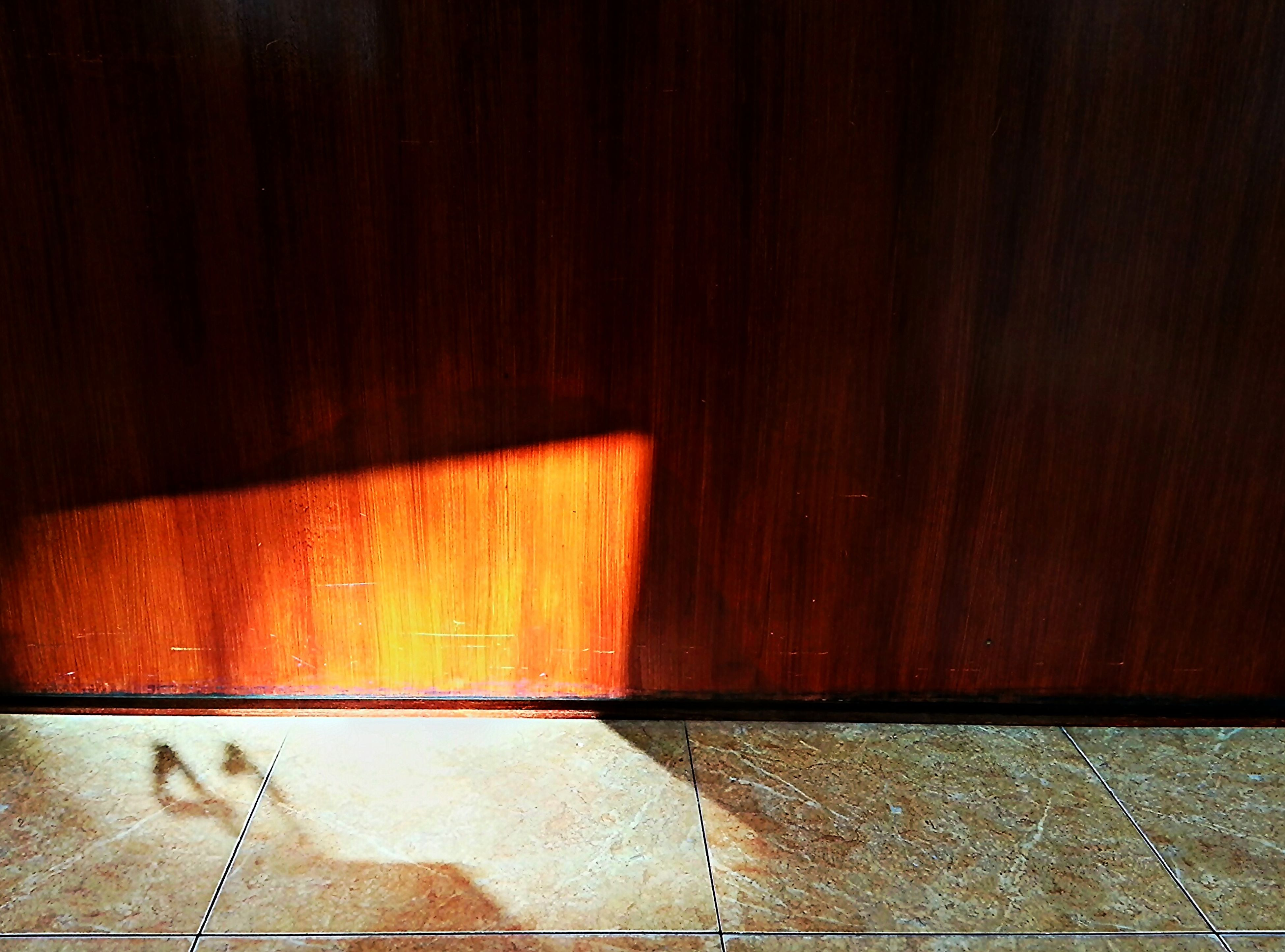 indoors, wood - material, flooring, wall - building feature, shadow, empty, wooden, door, hardwood floor, built structure, architecture, absence, tiled floor, sunlight, wood, wall, no people, high angle view, floor, home interior