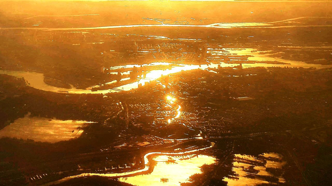 Sunset Water Textured  Travel Looking Through Window Flying Sky Sunbeam Commercial Airplane Traveling Travel Photography Amazing View Photography Taking Pictures Flying High View From The Window... Beautiful Dutch Landscape Dutch Countyside Scenics Sunlight Beauty In Nature Eye4photography  City Cityscape