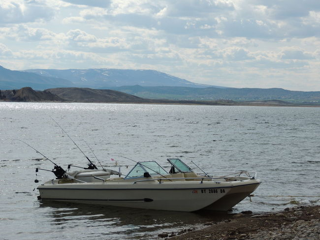 Water Transportation Beach Landscape Landscape_photography Waterphotography Fishingtrip Flaming Gorge, Utah Boating In The Lake Lake View Fishing Equipment Fishing Pole Fishing Boat Boat Fishing Fishing Tackle Camping Trip Cloudyday