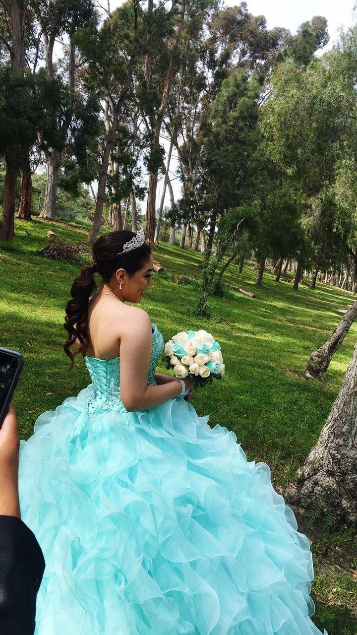 Side View Of Bride In Wedding Dress Standing On Field