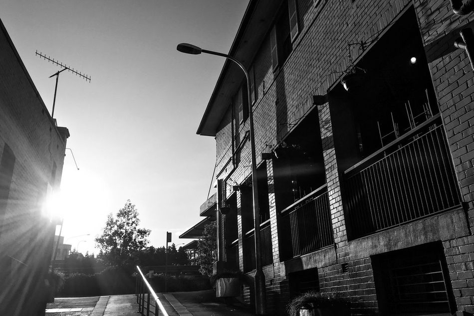 Architecture Building Exterior Built Structure Street Light Outdoors Street No People Day Sunlight Low Angle View Sky City Shadows & Lights Monochrome