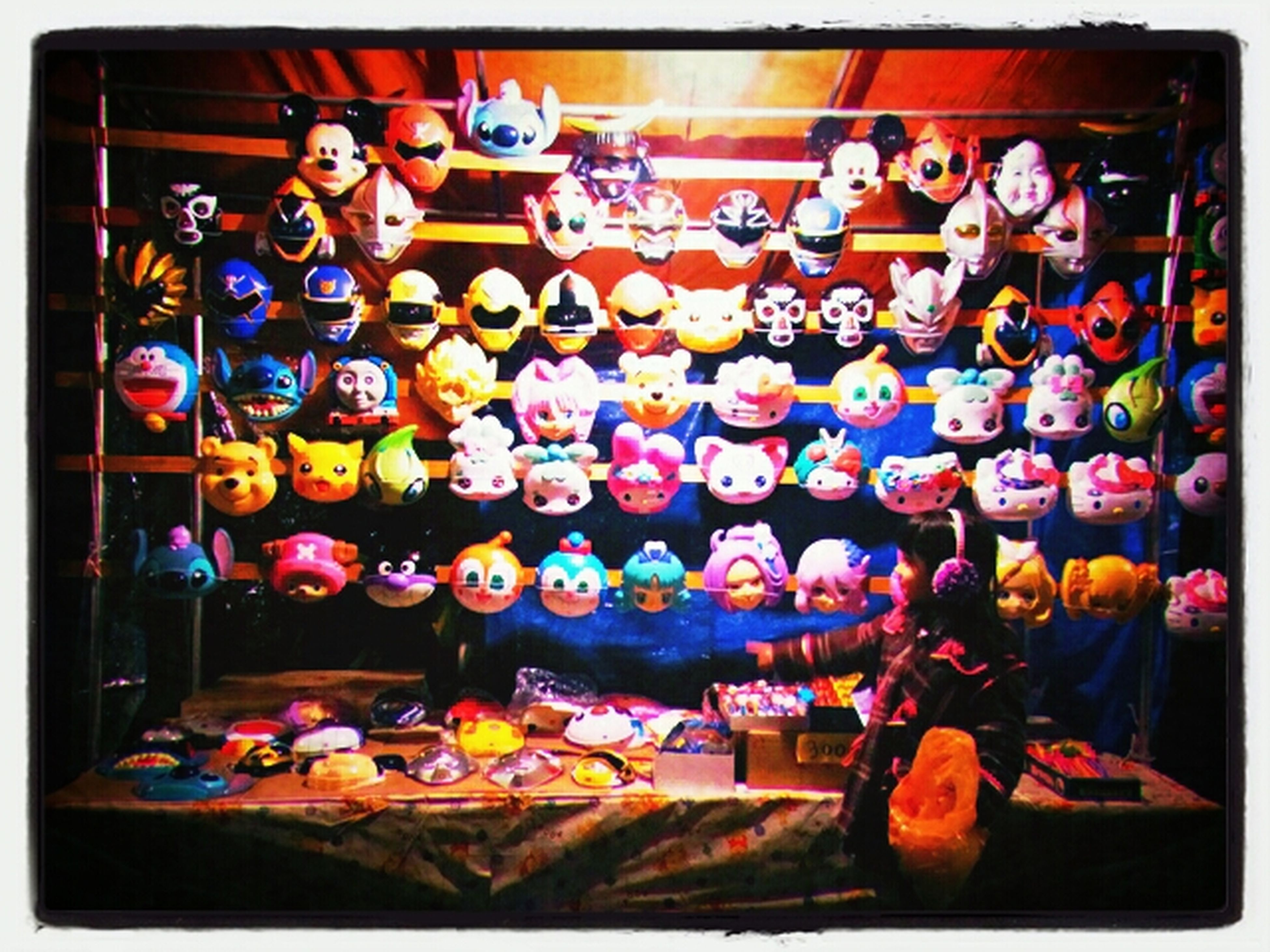 transfer print, auto post production filter, large group of objects, indoors, abundance, multi colored, variation, retail, arrangement, choice, for sale, still life, tradition, childhood, in a row, collection, market stall, celebration, human representation, cultures