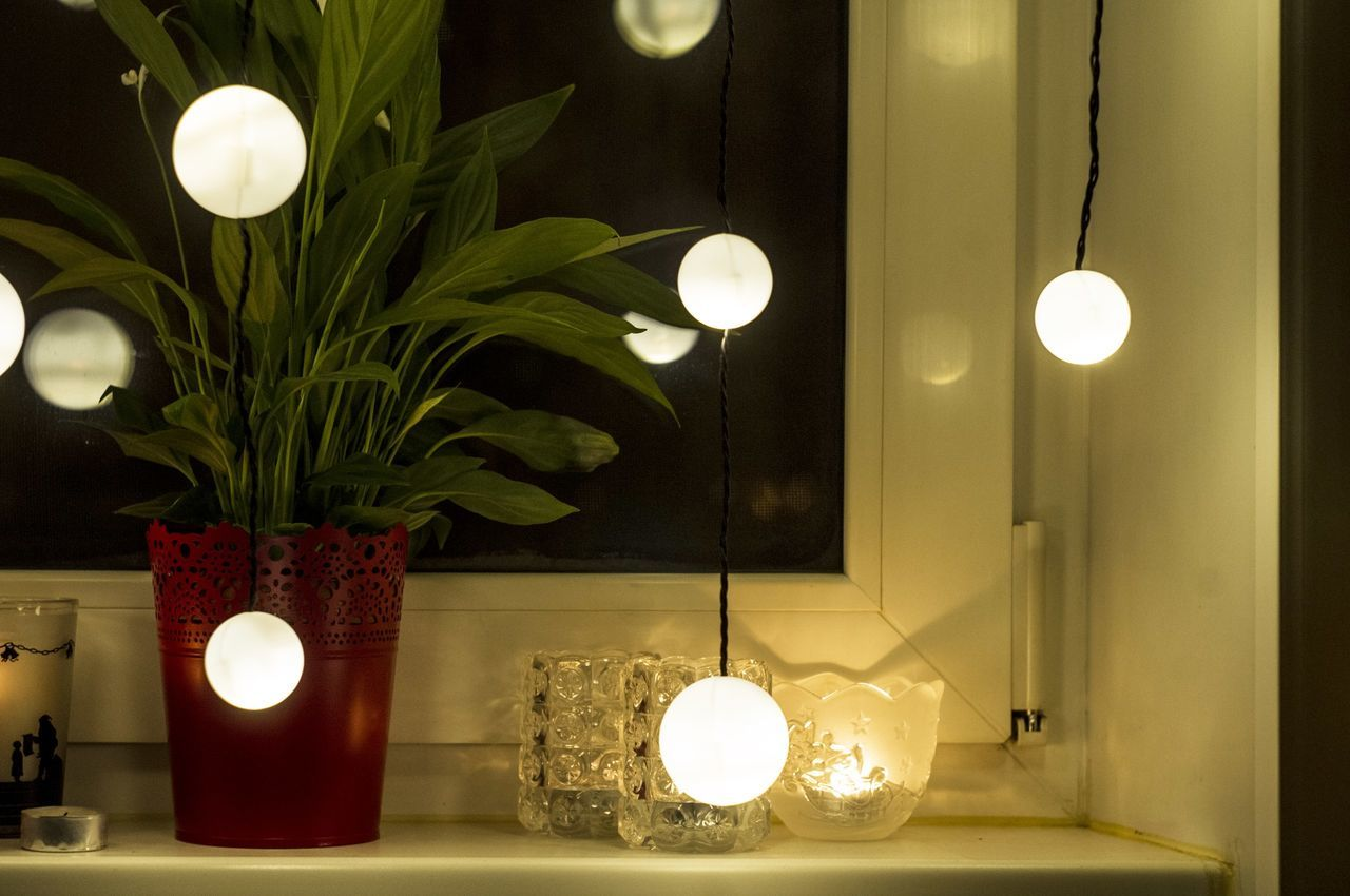 illuminated, lighting equipment, glowing, light bulb, lit, electricity, candle, decoration, electric lamp, night, electric light, indoors, flame, tea light, no people, hanging, home interior, lamp shade, floor lamp, lantern, light beam, christmas decoration, home showcase interior, close-up, filament