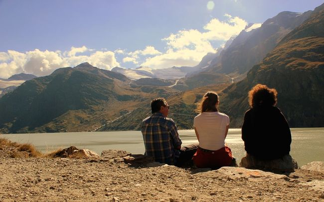 Mountain Mountain Range Sitting Togetherness Person Relaxation Beauty In Nature Idyllic Sky Travel Destinations Cloud Cloudy Weather Saasfee Switzerland Suisse  Saas Fee Nature Beauty In Nature People And Places Lake Water Family Love
